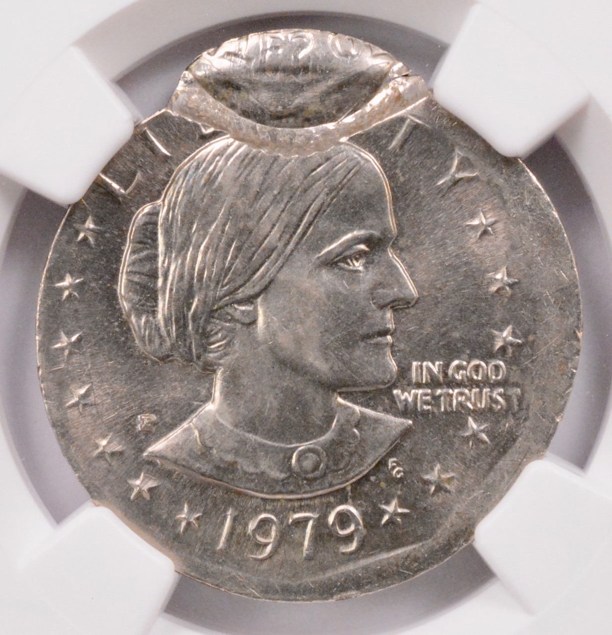 NGC $1 1979-P SBA on Quarter Planchet & 5% Partial Brockage